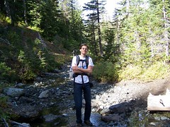 Todd at stream crossing, attempting EK pose.