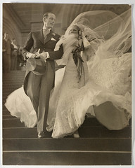 Musical stars Madge Elliott and Cyril Ritchard's wedding, St Mary's Cathedral, Sydney, 16 September 1935 / photograph by Sam Hood (State Library of New South Wales collection) Tags: wedding bride weddingdress groom bridegroom veil bouquet tophatted tailcoat musicalstars stmaryscathedral madgeelliott cyrilritchard stairs silvergelatine celebrity blustery gusty windgust sepia flowing 1935 windy steps largeformatnegative airy samhood tophat womensday statelibraryofnewsouthwales australian australia peterpan hook callalilies foaf:depicts=httpnlagovaunlaparty584242 xmlns:foaf=httpxmlnscomfoaf01 foaf:depicts=httpnlagovaunlaparty575334 morningcoat casamento vestido noiva vestidodenoiva noivo celebridade escada escadaria chapéu véu mariage arumlillies boda casamiento novios vestidodenovia