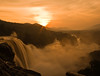 When the mist flew towards the Sun (saternal) Tags: sunset wallpaper sun india nature river landscape waterfall redsky southindia athirapally scneary indiaimages keralawaterfalls saternal goldstaraward sunsetsandsunrisesgold