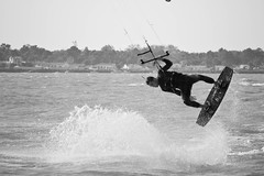 3.Val' during kitesurfing session @ le de R (Doudou) Tags: sea bw mer white kite black beach water speed canon de jump noir waves ile nb larochelle 70300mm tamron vagues rider kitesurf plage blanc saut r vitesse 400d