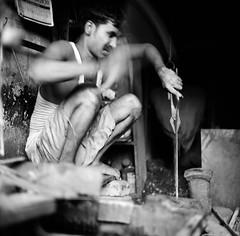 Blacksmith, Kolkata. (ndnbrunei) Tags: blackandwhite bw india 120 6x6 tlr film rollei rolleiflex mediumformat square kodak bn mf blacksmith kolkata atwork nam rolleiflex28f backstreets classicblackwhite autaut rolleigallery ndnbrunei kodak400tmy2 neroameta