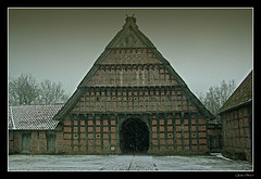 A rework of a photo of a barn in Cloppenburg from 1750 during snowfall (- Carsten -) Tags: old schnee winter sky house snow building museum barn digital canon germany deutschland eos alt farm himmel haus grau 1750 alemania allemagne gebude 18thcentury heimat alemanha halftimbered cloudysky duitsland fachwerk landleben norddeutschland niedersachsen lowersaxony northgermany scheune rurallife cloppenburg schneefall northerngermany schneeflocken 400d abigfave canoneos400d canon400d 18jahrhundert platinumheartaward bedeckterhimmel cgennert vanagram carstengennert museumsdorfcloppenburg