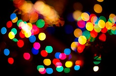 Are we human, or are we dancing bokeh balls of light? (Kirpernicus) Tags: christmas abstract color fun 50mm lights holidays colorful dof bokeh f14 balls human thekillers canonef50mmf14usm bokehlicious goldenbokeh ayearofholidays