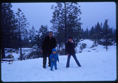 James (in blue) & Robert throw snowballs as our dad watches. (12/1971)