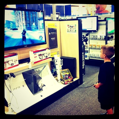 Project 365 163/365: My child apparently disappeared into the maze @BestBuy. I found him gaming.