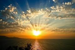 Through the clouds (esther**) Tags: light sunset sea sky reflection colors beautiful clouds island bravo view greece rays sunrays rhodes interestingness7 interestingness378 holidaysvacanzeurlaub