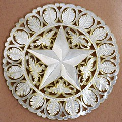 A 2 1/2-inch, hand-carved mother-of-pearl Bethlehem star button.