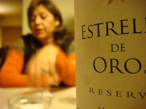 Maria Eugenia at the dinner table. The wine is obviously Chilean...