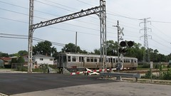 Westbound CTA Yellow line / Skokie Swift train at the Kostner Avenue railroad crossing. Skokie Illinois. August 2008.