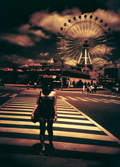 Chatan, OkinawaLet's play in the surreal circus! (theCarol) Tags: travel summer vacation sky woman flower film girl japan lomo lca crossprocessed cross processing ferriswheel  okinawa   chatan      thecarol 200808 ctoe platinumheartaward