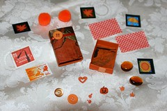 Busy Box - Craft Kit - Altered Matchbox Contents (Pictures by Ann) Tags: orange altered scrapbook paper children rainyday expression buttons stickers creative craft boredom stamp buster kit adults matchbox postagestamp busybox artkit travelkit womanmade alteredmatchbox quickcraft boredombuster madebyawoman atckit embellshment rainydaykit handmademadebyhand