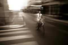 Sur Votre Vélo (Dave G Kelly) Tags: street motion blur paris france bike bicycle sepia canon 350d streetphotography motionblur rue panning français vélo parisian lightroom panshot davegkelly davegkellyportfolio
