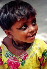 Phoolon say batain!!! (nida shams) Tags: flowers pakistan girl smile yellow eyes talking sindh abigfave 9of10 goldstaraward
