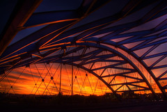 Bridge Sunset (Thad Roan - Bridgepix) Tags: bridge sunset sky sunlight color clouds colorado colorful arch steel arches denver viaduct explore brenda span hdr bridging speer confluencepark southplatteriver photomatix auraria bridgepixing bridgepix 200810