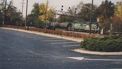 Eastbound short Burlington Northern freight train. West Hindsdale Ilinois. October 1989.