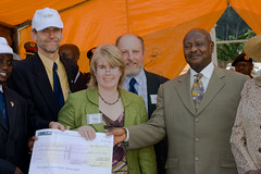 Dr Helen Smith (Sponsor a Nurse trustee) presenting a cheque for £50,000 to President Museveni