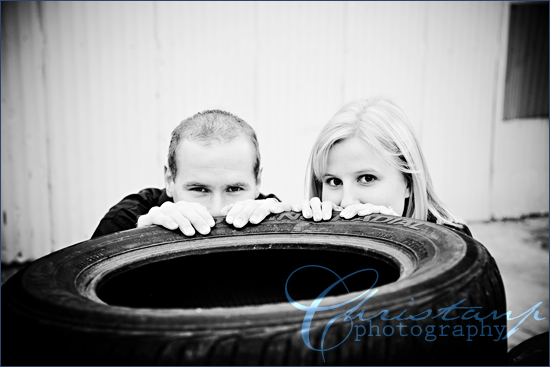 Tim and Beth behind tires by ChristanP Photography