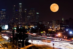 Moonrise over the LA skyline (Eric Wolfe) Tags: california city usa moon skyline night buildings landscape la losangeles downtown cityscape nightscape unitedstates metro towers fullmoon moonrise freeway astronomy skyscapers original:filename=200812120304jpg