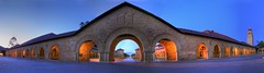 Twilight Aura at Stanford - Panorama (Jill Clardy) Tags: panorama tower university arch image pano columns quad panoramic explore 180 stanford 100views hoover bluehour 500views palo alto hdr degree 1000views photomatix explored ilovephotomatix ©2009jillclardy