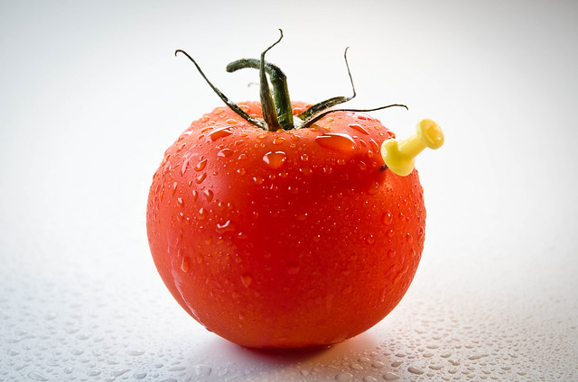 red tomato with a yellow pin