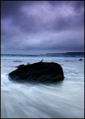 Sennen (ashleyhampson) Tags: sea storm water rock clouds sunrise coast movement long exposure cornwall power cloudy atmosphere