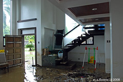 flood ii (marsthird12) Tags: street city light urban white house home window weather stairs photography lights living photo bucket chair nikon asia stair day afternoon play exercise mud flood furniture room philippines photojournalism machine ground sala swing disaster noon floods treadmill iloilo pilipinas calamity photojournalist philippine pavia jounalism d80 nikond80