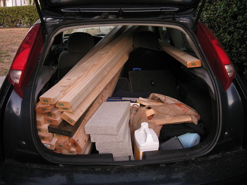 2000 Ford Focus full of project materials for wood storage shed construction