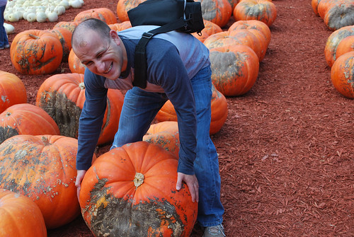 joe picking up giant pumpkin