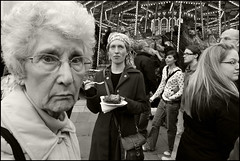 All the fun of the fair (Briggate.com) Tags: bw monochrome closeup nikki action candid leeds milleniumsquare hoppe sr148 kristkindlemarkt whyiamnotmadaboutbokeh asp1010584bw