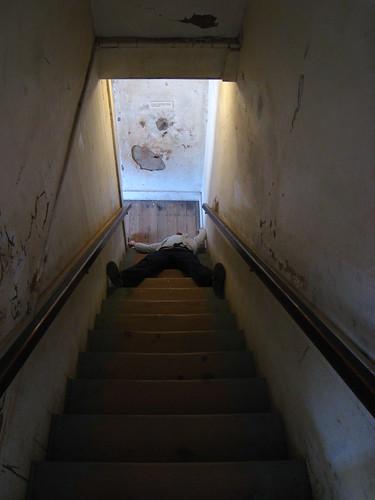 Dead on the stairs (we aim for verisimilitude and fail)
