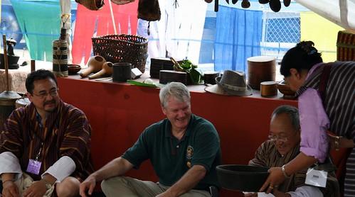 congressman Brian Baird sampling bhutanese cuisine