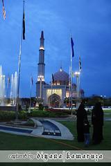 Travel   Putra Mosque (Diyana Kamaruza) Tags: sunset night canon landscape evening asia walk muslim islam mosque malaysia putrajaya malaysian waktu masjid malam melayu malay senja putra selangor petang bendera masuk diyana jubah berjalan sembahyang putrajayamalaysia 450d kamaruzaman diyanakamaruza kamaruza