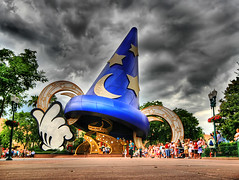 Mickey Conjuring a Storm (` Toshio ') Tags: vacation sky people usa holiday storm color hat america orlando colorful unitedstates florida south perspective ears disney mickey tourists multipleexposure southern mickeymouse thunderstorm hdr stormclouds sorcerer sorcerersapprentice toshio kissimee 3exposure mywinners highdynamicresolution aplusphoto hollywoodstudios disneyhollywoodstudios