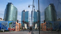 A Tale of Two Cities (Canicuss) Tags: street city blue windows red sky urban orange reflection glass architecture skyscraper buildings mirror downtown mo kansascity sidewalk missouri kc oval midland countbasie powerlightdistrict worldheadquarters blockbuilding mywinners powerandlight hrblockbuilding canicuss