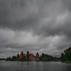 Trakai castle (R. O. Flinn) Tags: sky lake brick castle architecture clouds landscape towers medieval fortress lithuania vilnius trakai breathless