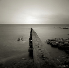Outlet (Andy-artin) Tags: uk longexposure sea 120 beach analog dusk pipe hasselblad sewage pan analogue groyne ilford outlet sunderland emulsion 500cm hendon wearside northeastengland panf50 ryhope