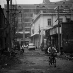 the quieter days (memetic) Tags: china street bw 6x6 buildings asian uncut blackwhite cyclist tmax chinese demolition cycle 100  vanishing tianjin rubble  arax60 disappearing