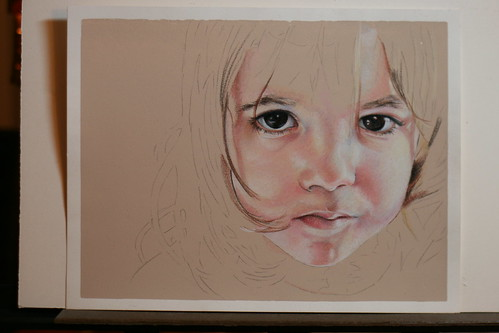 Photo of as yet untitled colored pencil portrait of my daughter.