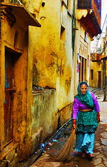 Untouchable [Dalit] woman, Vrindavan, India (Jitendra Singh : Indian Travel Photographer) Tags: old travel blue woman india house green yellow doors textures oldhouse cpc hindu brij dalit untouchable mathura uttarpradesh jiten travelphotography jitendra braj 5photosaday jitender jitendrasingh indiaphoto jitens bestphotojournalist indiantravel brajbhomi wwwjitenscom gettyphotographer bestindianphotographers jitensmailgmailcom wwwindiantravelphotographercom famousindianphotographer famousindianphotojournalist gettyindianphotographer