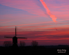 Windmill at Sunrise (JeroenKoning) Tags: orange mill windmill clouds sunrise jeroen nikon wind d70s molen wieken zonsopgang silhouett koning evine protestboarder evinenl