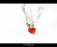 Strawberry ... [ S p l a s h ] (Faisal | Photography) Tags: red white water speed canon eos is high strawberry ali l usm splash 2008 ef f4 faisal 24105mm 50d flickrsbest anawesomeshot