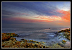 Last Shades Of The Day (Falcon EyE) Tags: longexposure nightphotography blue red sea sky cloud brown abstract art nature night clouds dark landscape harbor boat fishing fisherman nikon perfect colorful sailing photographer spectrum outdoor horizon middleeast dramatic quay ciel syria 2008 hdr  syrien syrie lattakia  18135  lowlightphotography d80 nikond80 waseemasmar naturewatcher goldstaraward seaacape   photosfromsyria photosfromlattakia  fotodilattakia