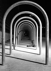 Arches. (Ian McWilliams.) Tags: bike canon 350d stand chains lock tube security 1855mm efs aplusphoto macaz1977
