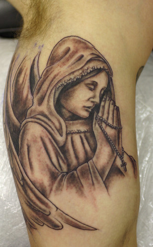 Angel and Cross Tattoo by The Tattoo Studio