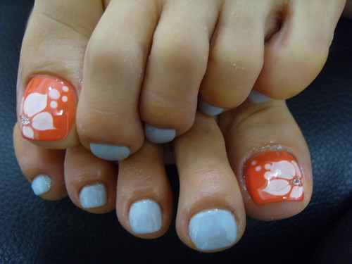 Baby blue orange white flowers toe nails designs, toe nail art designs