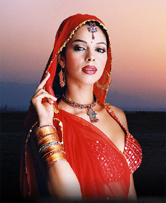 Mallika Sherawat - the ethnic look, wearing red sari and ethnic jewelry
