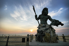 King Neptune (` Toshio ') Tags: ocean sea people woman sun shells fish man statue clouds sunrise fence person virginia sand colorful turtle rail atlantic va seaturtle virginiabeach neptune trident hamptonroads toshio kingneptune tidewater platinumheartaward