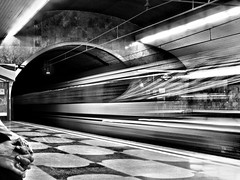 Waiting for the next train (hiskinho) Tags: madrid city travel viaje windows light bw luz ruta speed train underground faro tren mirror luces reflex energy hand time metro sale ciudad tunnel cable dirty bn ventanas espejo ref