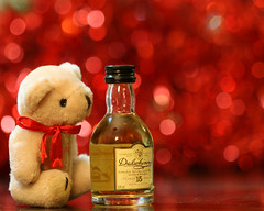 Mmmmmmmm! That Dalwhinnie 15 year-old looks interesting, even if it is only a miniature! (Mukumbura) Tags: bear christmas xmas decorations red crimson miniature teddy ornaments tinsel whisky scotch hogmanay mywinners dalwhinnie15yearoldsinglemaltwhisky