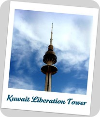 Kuwait Liberation Tower (SWAIDAN  to Syria  G.W.L.K_) Tags: city red sky white black color green tower birds proud club clouds canon photo pigeon dove science kuwait liberation q8 abigfave kuwaitliberationtower crystalaward kuwaitscienceclub swaidan flickrlovers